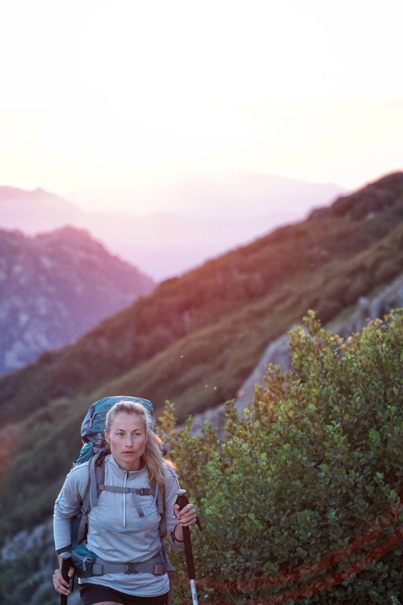 woman hiking, avoid leg and foot pain